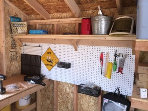peg board in garden shed organizes tools